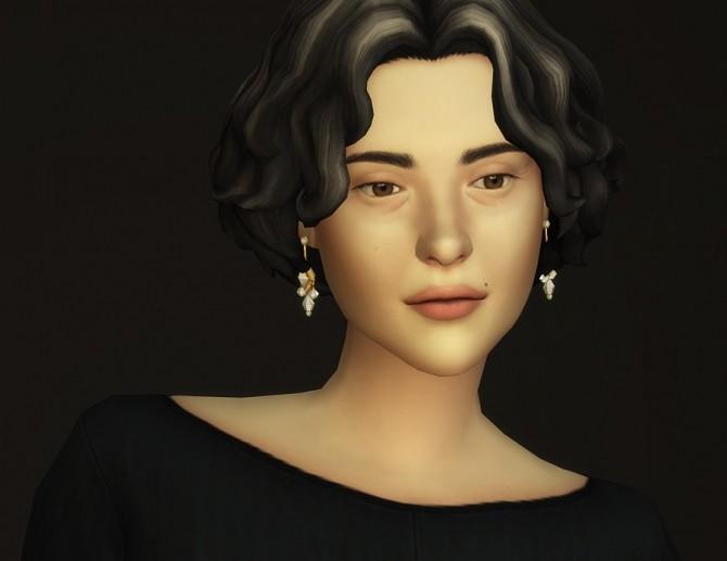 GP07 Curly Mid Hair Edit V1 at Rusty Nail image 2261 670x517 Sims 4 Updates
